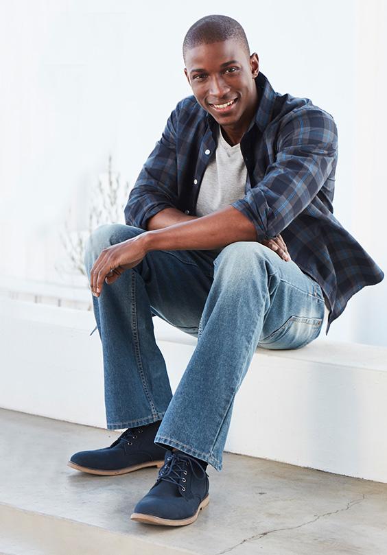 man sitting while wearing oakridge slim fit denim